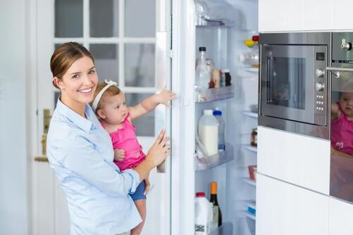 mom daughter opening fridge